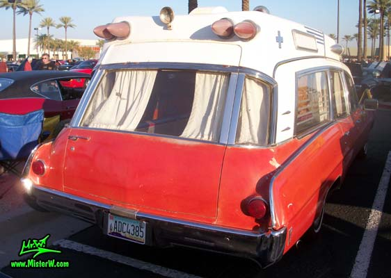 Photo of a red & white 1968 Pontiac Ambulance at the Scottsdale Pavilions Classic Car Show in Arizona. 68 Pontiac Ambulance Rearview