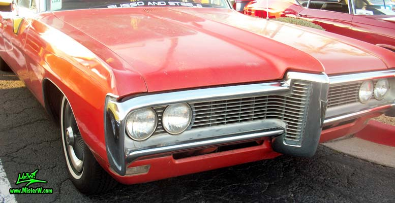Photo of a red & white 1968 Pontiac Ambulance at the Scottsdale Pavilions Classic Car Show in Arizona. 68 Pontiac Ambulance Chrome Front Grill