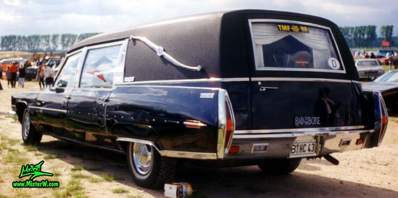 Photo of a black 1972 Cadillac Hearse at a Classic Car Meeting in Germany. 72 Caddy Hearse rearview