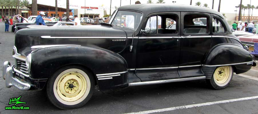 Photo of a black 1947 Hudson Super Six 4 Door Sedan at the Scottsdale Pavilions Classic Car Show in Arizona. 1947 Hudson Super Six Sedan