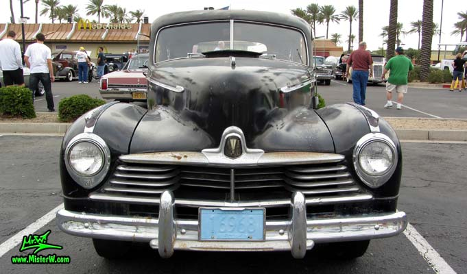 Photo of a black 1947 Hudson Super Six 4 Door Sedan at the Scottsdale Pavilions Classic Car Show in Arizona. Frontview of a 1947 Hudson Super Six