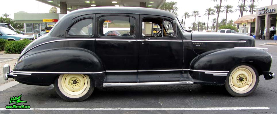 Photo of a black 1947 Hudson Super Six 4 Door Sedan at the Scottsdale Pavilions Classic Car Show in Arizona. Sideview of a 1947 Hudson Super Six