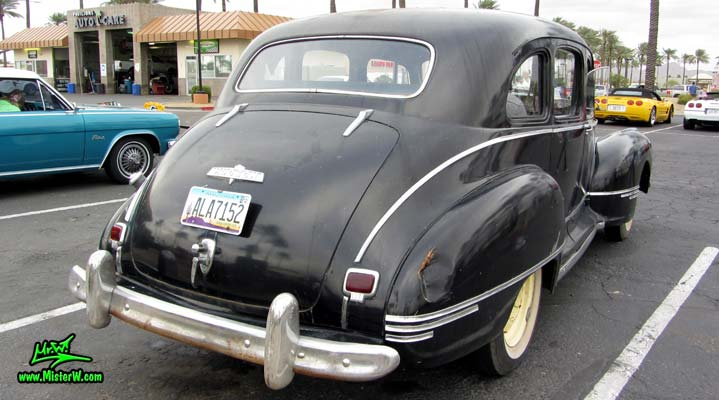 Photo of a black 1947 Hudson Super Six 4 Door Sedan at the Scottsdale Pavilions Classic Car Show in Arizona. Back of a 47 Hudson Super 6