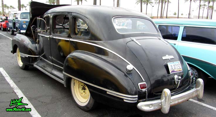 Photo of a black 1947 Hudson Super Six 4 Door Sedan at the Scottsdale Pavilions Classic Car Show in Arizona. 1947 Super 6