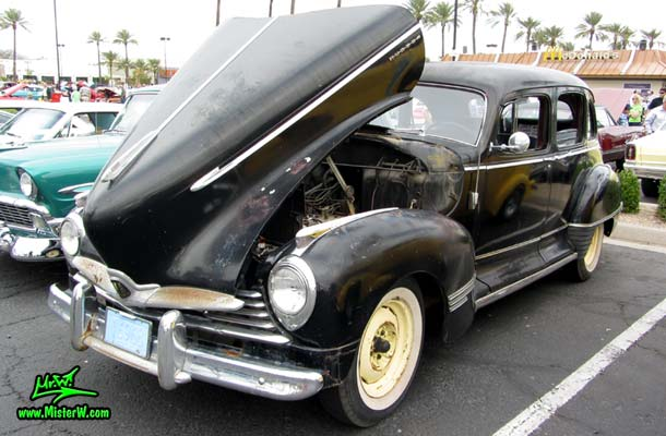 Photo of a black 1947 Hudson Super Six 4 Door Sedan at the Scottsdale Pavilions Classic Car Show in Arizona. 1947 Hudson Super Six with open hood