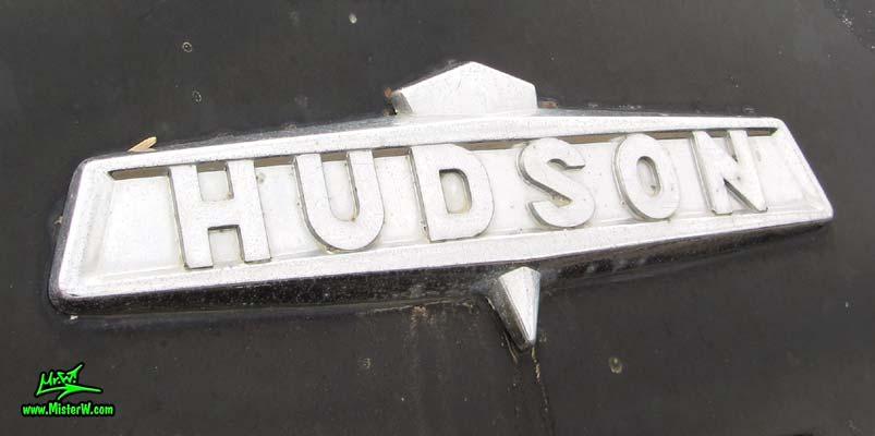 Photo of a black 1947 Hudson Super Six 4 Door Sedan at the Scottsdale Pavilions Classic Car Show in Arizona. 1947 Hudson Chrome Emblem