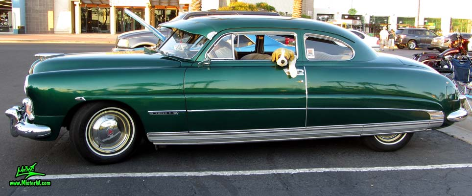 Photo of a green 1950 Hudson Super 6 Hardtop Coupe at the Scottsdale Pavilions Classic Car Show in Arizona. Sideview of a 1950 Hudson Super 6 Hardtop Coupe