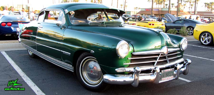 Photo of a green 1950 Hudson Super 6 Hardtop Coupe at the Scottsdale Pavilions Classic Car Show in Arizona. Frontview of a 1950 Hudson Super 6 Hardtop Coupe