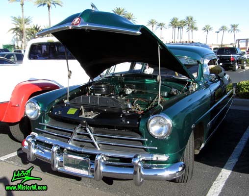 Photo of a green 1950 Hudson Super 6 Hardtop Coupe at the Scottsdale Pavilions Classic Car Show in Arizona. 50 Hudson Super Six 2 Door Hardtop Coupe