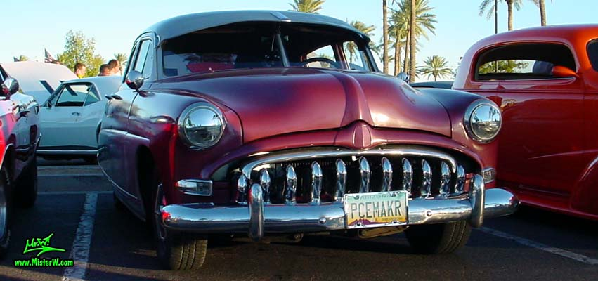Photo of a red 1951 Hudson Pacemaker 4 Door Sedan at the Scottsdale Pavilions Classic Car Show in Arizona. 1951 Hudson Pacemaker