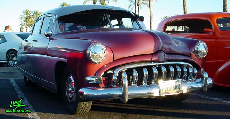 Photo of a red 1951 Hudson Pacemaker 4 Door Sedan at the Scottsdale Pavilions Classic Car Show in Arizona. 1951 Hudson Sideview