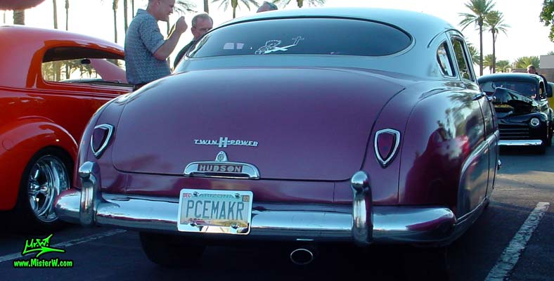 Photo of a red 1951 Hudson Pacemaker 4 Door Sedan at the Scottsdale Pavilions Classic Car Show in Arizona. 1951 Hudson Rearview