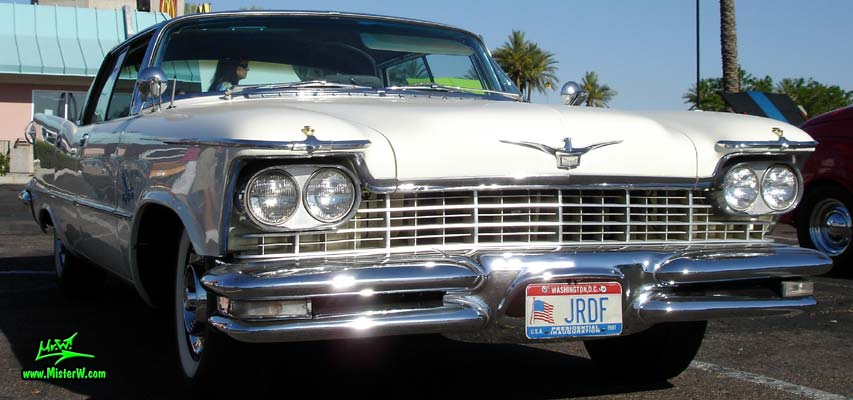 Photo of a white 1957 Imperial 4 Door Hardtop Sedan at the Scottsdale Pavilions Classic Car Show in Arizona. 57 Imperial