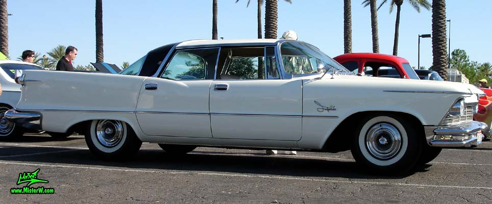 Photo of a white 1957 Imperial 4 Door Hardtop Sedan at the Scottsdale Pavilions Classic Car Show in Arizona. 57 Imperial 4 Door Hardtop