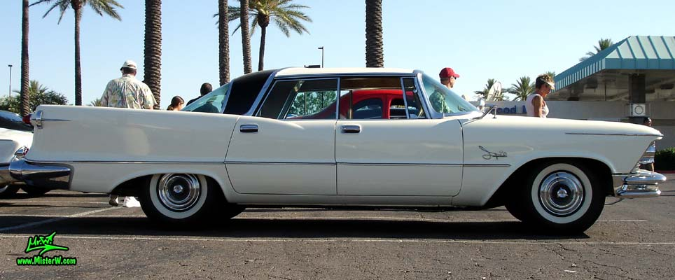 Photo of a white 1957 Imperial 4 Door Hardtop Sedan at the Scottsdale Pavilions Classic Car Show in Arizona. Sideview of a 57 Imperial