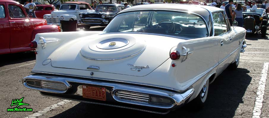 Photo of a white 1957 Imperial 4 Door Hardtop Sedan at the Scottsdale Pavilions Classic Car Show in Arizona. Tailfins of a 57 Imperial Sedan