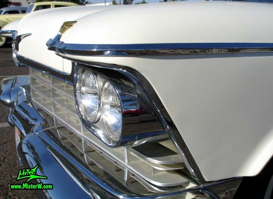 Photo of a white 1957 Imperial 4 Door Hardtop Sedan at the Scottsdale Pavilions Classic Car Show in Arizona. Headlight & Chrome Trim of a 57 Imperial