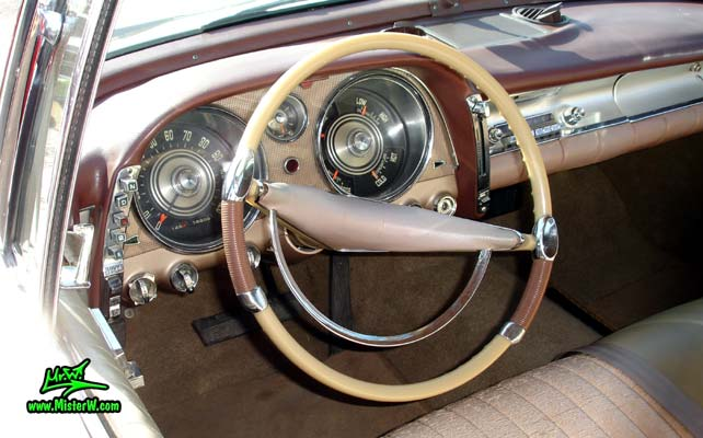 Photo of a white 1957 Imperial 4 Door Hardtop Sedan at the Scottsdale Pavilions Classic Car Show in Arizona. Dashboard & Speedometer of a 57 Imperial