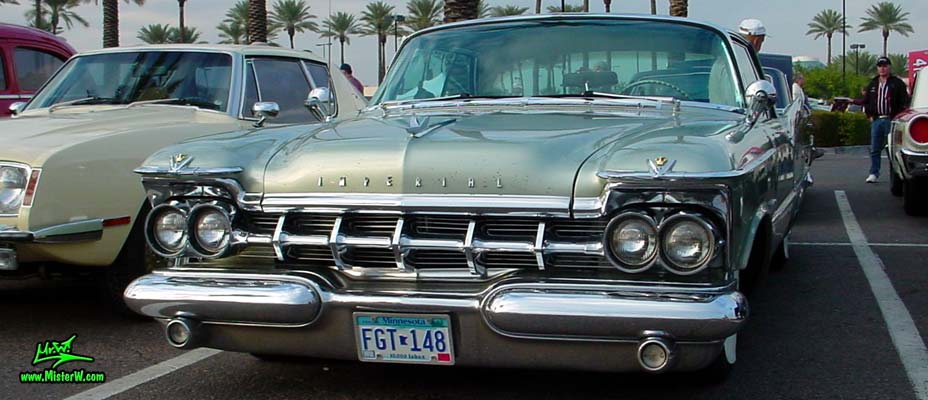 Photo of a turquoise 1959 Imperial 2 Door Hardtop Coupe at the Scottsdale Pavilions Classic Car Show in Arizona. 1959 Imperial Chrome Grill