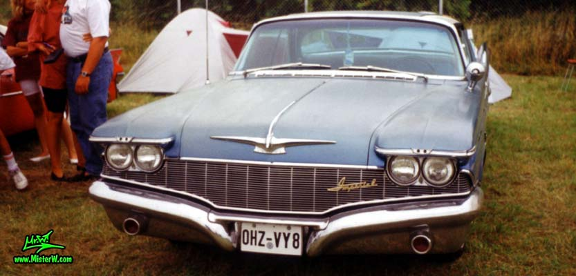 Photo of a blue 1960 Imperial 2 Door Hardtop Coupe at a classic car meeting in Germany. 1960 Imperial Frontview