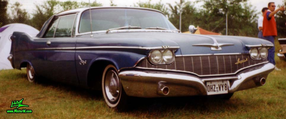 Photo of a blue 1960 Imperial 2 Door Hardtop Coupe at a classic car meeting in Germany. 1960 Imperial Sideview