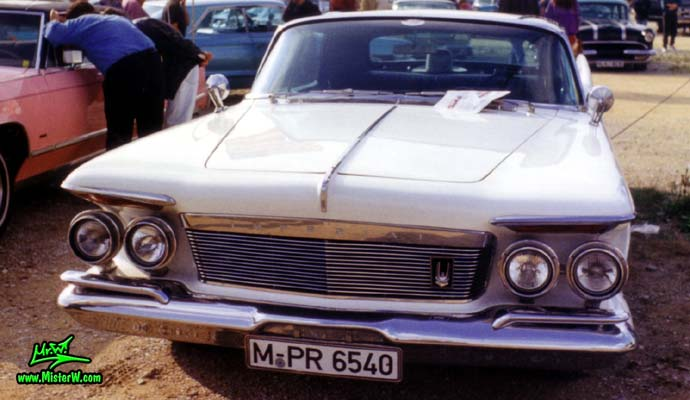 Photo of a white 1961 Imperial 4 Door Hardtop Sedan at a classic car meeting in Germany. 61 Imperial