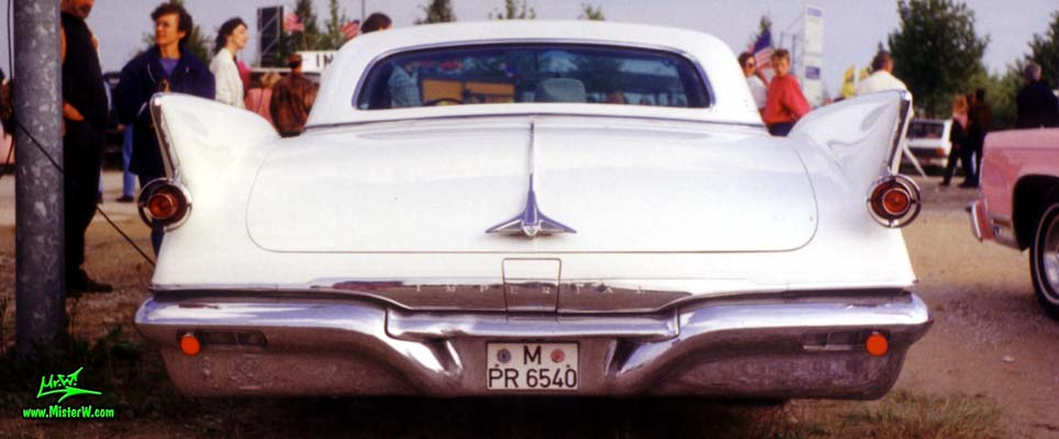 Photo of a white 1961 Imperial 4 Door Hardtop Sedan at a classic car meeting in Germany. 1961 Imperial Sedan Rearview