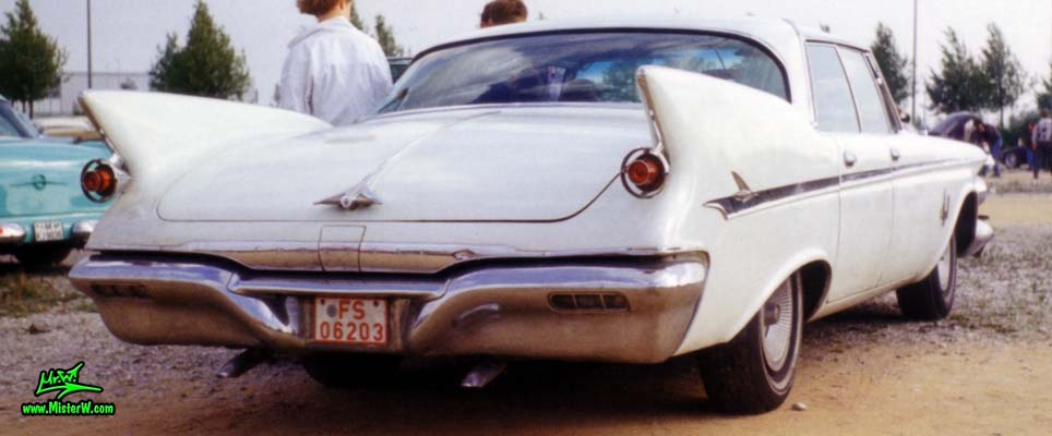 Photo of a white 1961 Imperial 4 Door Hardtop Sedan at a classic car meeting in Germany. 61 Imperial 4 Door Rearview