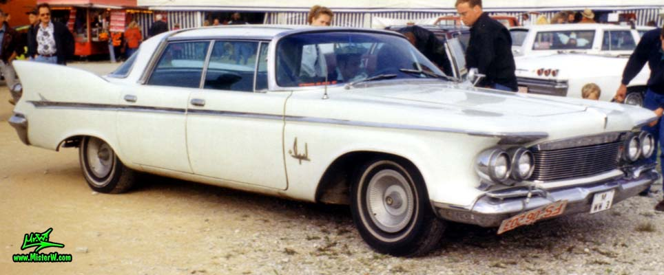 Photo of a white 1961 Imperial 4 Door Hardtop Sedan at a classic car meeting in Germany. 61 Imperial 4 Door Sideview