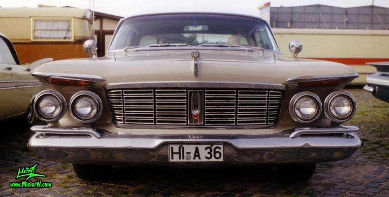 Photo of a brown 1963 Imperial 4 Door Hardtop Sedan at a classic car meeting in Germany. 63 Imperial Frontview
