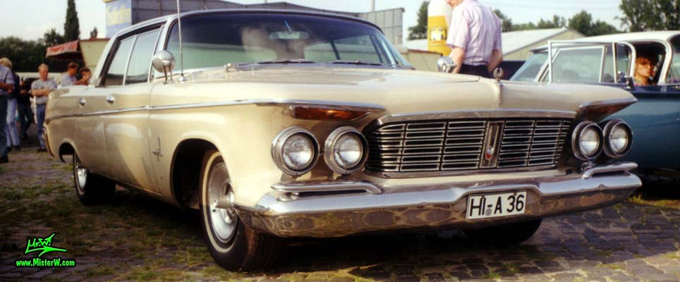Photo of a brown 1963 Imperial 4 Door Hardtop Sedan at a classic car meeting in Germany. 63 Imperial Sideview