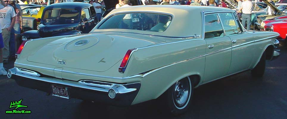 Photo of a white 1963 Imperial 4 Door Hardtop Sedan at the Scottsdale Pavilions Classic Car Show in Arizona. 1963 Imperial Sedan Sideview