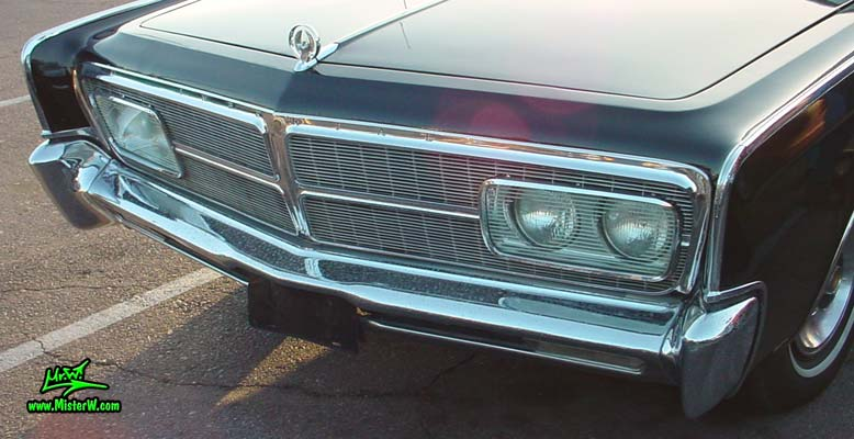 Photo of a black 1965 Imperial 2 Door Hardtop Coupe at a classic car meeting in Phoenix, Arizona. 1965 Imperial Chrome Grill