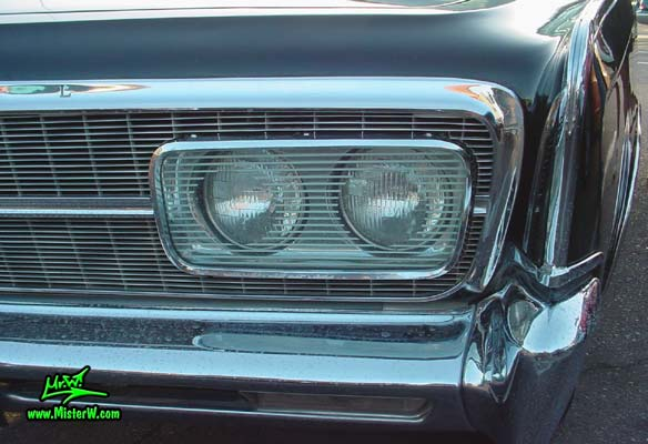 Photo of a black 1965 Imperial 2 Door Hardtop Coupe at a classic car meeting in Phoenix, Arizona. 1965 Imperial Headlights
