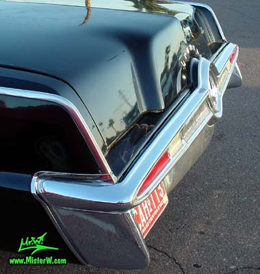 Photo of a black 1965 Imperial 2 Door Hardtop Coupe at a classic car meeting in Phoenix, Arizona. 1965 Imperial Rear Bumper & Tail Lights