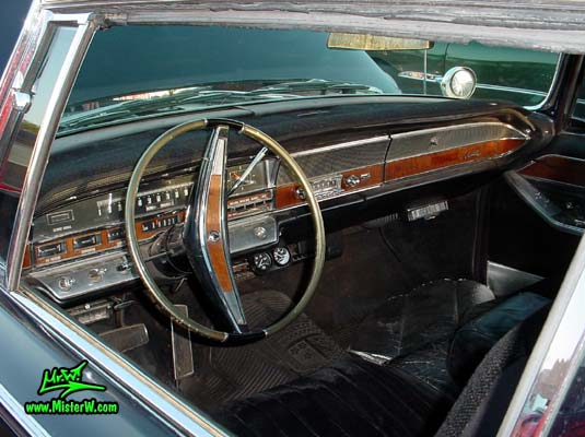 Photo of a black 1965 Imperial 2 Door Hardtop Coupe at a classic car meeting in Phoenix, Arizona. 1965 Imperial Odometer & Dashboard