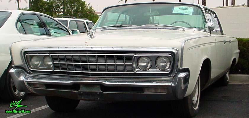Photo of a white 1966 Imperial LeBaron 4 Door Hardtop Sedan at the Scottsdale Pavilions Classic Car Show in Arizona. 66 Imperial LeBaron
