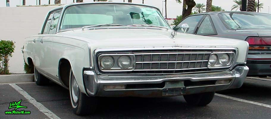 Photo of a white 1966 Imperial LeBaron 4 Door Hardtop Sedan at the Scottsdale Pavilions Classic Car Show in Arizona. 1966 Imperial LeBaron Sedan Sideview