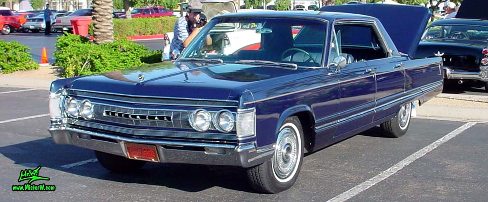 Photo of a blue 1967 Imperial 4 Door Hardtop Sedan at the Scottsdale Pavilions Classic Car Show in Arizona. 67 Imperial
