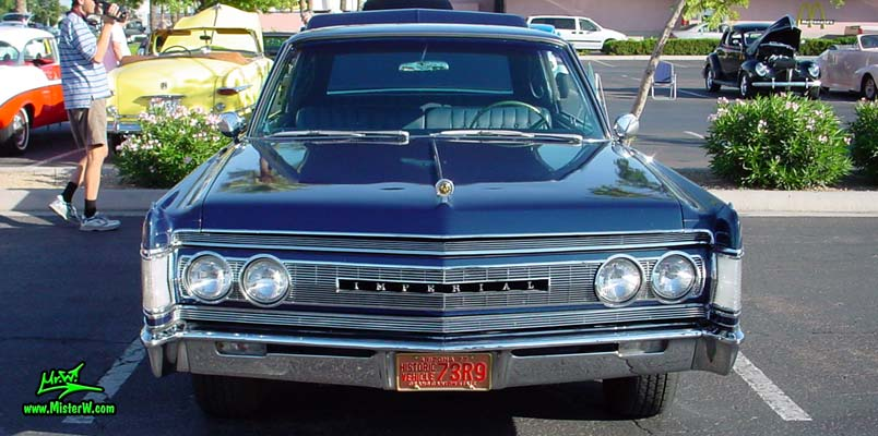 Photo of a blue 1967 Imperial 4 Door Hardtop Sedan at the Scottsdale Pavilions Classic Car Show in Arizona. 1967 Imperial Frontview
