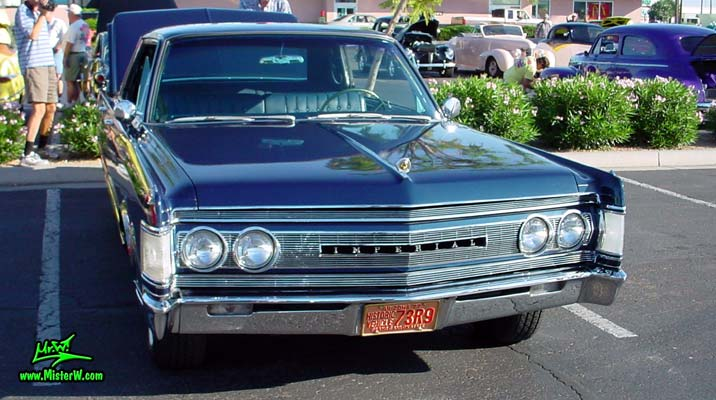 Photo of a blue 1967 Imperial 4 Door Hardtop Sedan at the Scottsdale Pavilions Classic Car Show in Arizona. 67 Imperial Head Lights