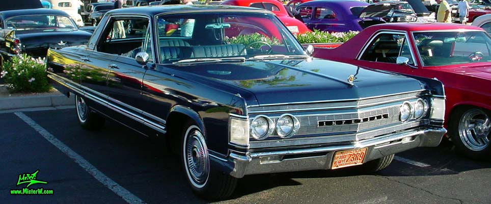 Photo of a blue 1967 Imperial 4 Door Hardtop Sedan at the Scottsdale Pavilions Classic Car Show in Arizona. 1967 Imperial 4 Door Sedan