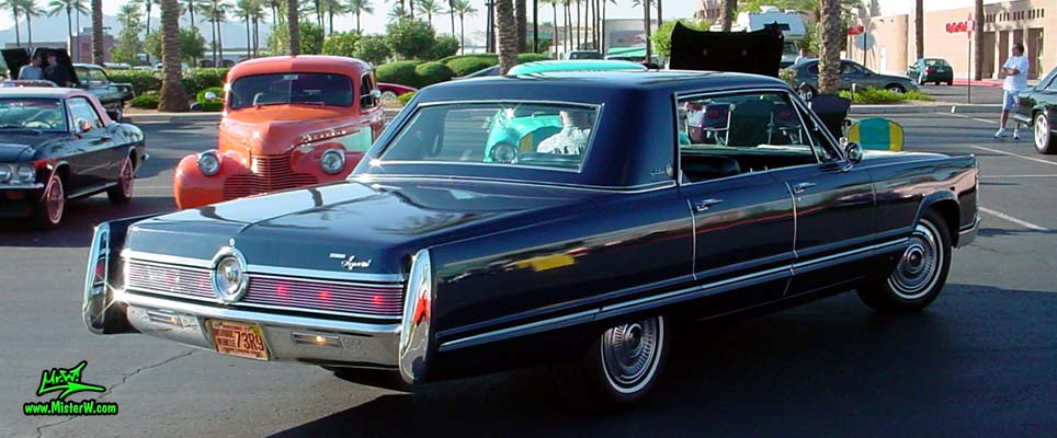 Photo of a blue 1967 Imperial 4 Door Hardtop Sedan at the Scottsdale Pavilions Classic Car Show in Arizona. 1967 Imperial Sedan Sideview