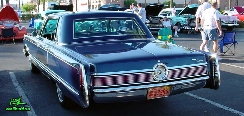 Photo of a blue 1967 Imperial 4 Door Hardtop Sedan at the Scottsdale Pavilions Classic Car Show in Arizona. 1967 Imperial Tail Fins