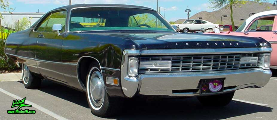Photo of a black 1971 Imperial 2 Door Hardtop Coupe at a Classic Car Meeting in Phoenix, Arizona. 1971 Imperial with hidden Head Lights
