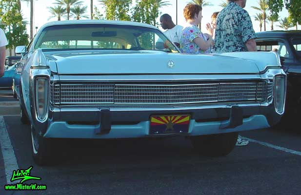 Photo of a blue 1973 Imperial 4 Door Hardtop Sedan at the Scottsdale Pavilions Classic Car Show in Arizona. 1973 Imperial Sedan with massive Chrome Grill & Bumper