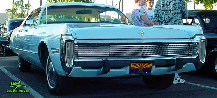 Photo of a blue 1973 Imperial 4 Door Hardtop Sedan at the Scottsdale Pavilions Classic Car Show in Arizona. 1973 Imperial Sedan with hidden Head Lights