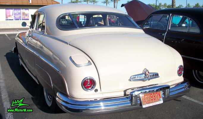 Photo of a tan 1949 Lincoln 9EL Series 4 door Sport Sedan with suicide doors at the Scottsdale Pavilions Classic Car Show in Arizona. Rear view of a 1949 Lincoln 9EL Series Sport Sedan
