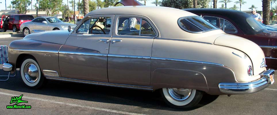 Photo of a tan 1949 Lincoln 9EL Series 4 door Sport Sedan with suicide doors at the Scottsdale Pavilions Classic Car Show in Arizona. Side view of a 1949 Lincoln 9EL Series Sport Sedan