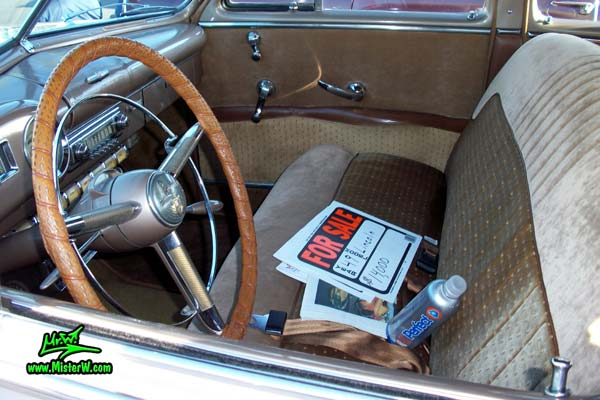 Photo of a tan 1949 Lincoln 9EL Series 4 door Sport Sedan with suicide doors at the Scottsdale Pavilions Classic Car Show in Arizona. Interior & dashboard of a 1949 Lincoln 9EL Series Sport Sedan